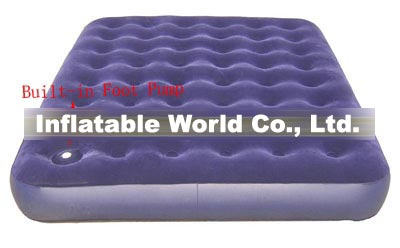Air bed with built-in foot pump